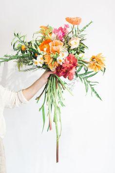 14 Super Sweet Summer Wedding Bouquets You'll Adore Eclectic French Tulip, Iris, Sweetpea & Icelandic Poppy Bouquet Poppy Wedding Bouquets, Poppy Bouquet, Wedding Flower Arrangements, Bride Bouquets, Floral Bouquets, Floral Wedding, Iris Bouquet, Wedding Orange, Purple Bouquets
