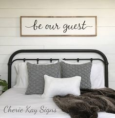 guest room decor, Be our guest sign (pictured above a queen size bed) » size 1 x 4 appx. » painted lettering » background color: white » lettering color: black » frame color: brown » this sign is able to be hung by the frame » Our signs are made for interior decorating; no clear coat