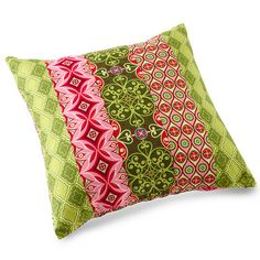 Three of a Kind  This pillow and the two pillows that follow were all designed by Judy Sams Sohn. Judy mixed prints from designer Patty Young's Mezzanine collection for Michael Miller fabrics. Get instructions for this pillow.