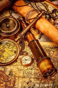 Picture of Vintage magnifying glass, compass, telescope and a pocket watch lying on an old map. stock photo, images and stock photography. Vinil Wallpaper, Bateau Pirate, Pirate Life, Vintage Maps, Antique Maps, Vintage Antiques, Vintage Items, Old Maps, Magnifying Glass