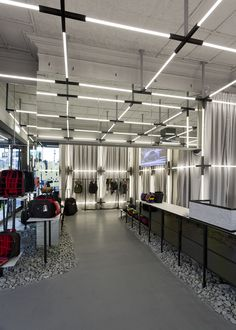 Muted luggage store dials down the colour to stylish effect. muted luggage store dials down the colour to stylish effect. Lighting Concepts, Linear Lighting, Lighting Design, Garage Lighting, Interior Lighting, Office Lighting, Retail Store Design, Retail Interior, Office Interior Design