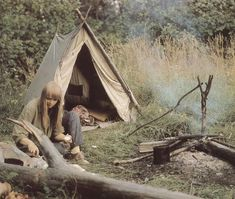 I love everything about this picture! The woods, the tent, her lovely Joni Mitchell hairdo...