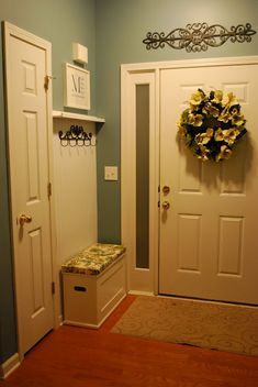 small foyer: beadboard, picture rail = lovly little mudroom... I would want some way to store shoes below bench without having to lift a lid