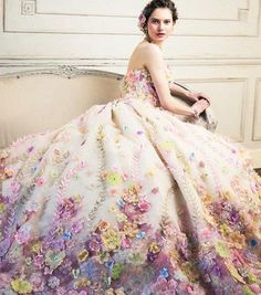 Splendidly romantic and incredibly detailed, we simply can't resist this gorgeous floral gown from Yumi Katsura! #wedding #weddingdress #purple #praisewedding #yumikatsura #gown #floral #flowers #bride