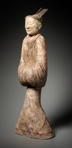 FIGURE OF A MAN IN COURTLY COSTUME Terracotta. China, Western Han (from 206 BC), TL-tested age. A stylistically rare, impressive sculpture from a tomb, very static and consistently symmetrical.