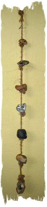 """Hag Stones, tied in a series, acting pretty much the same as a witches ladder (where feathers are tied in) hung in the corner of the main living room protects against witchcraft from other witches and keeps inhabitants """"grounded"""" (in contact with earth that is).  One can also tell your troubles to the stones while rubbing or stroking them, earth spirits will then help in solving them."""