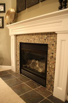 "Told the hubby I want to do slate mosiac tile for the fireplace.  Now that I've found this pic on @Thrifty Decor Chick's blog I know that I am right.  Hubby prefers glass mosaic, but we already have some ""bling: with our finky winery posters.  I think this will bring a nice natural element to the room."