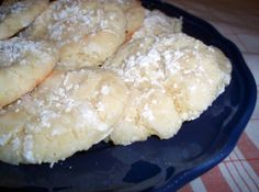 Death-by-Butter-Cookies {a.k.a., Gooey Butter Cookies} ~ 1 box Duncan Hines butter recipe cake mix. 1 stick butter. 1/4 tsp vanilla extract. 1 pkg cream cheese at room temperature (8 oz. pkg). 1 egg. Combine all ingredients with electric mixer until well blended. Chill dough for two hours. Roll into balls (about walnut size). Roll balls in powdered sugar. Bake on ungreased cookie sheet in 350 degree oven for 10-12 minutes. Dust with powdered sugar when completely cooled.