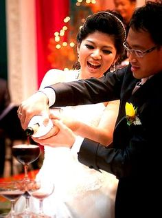 Intimate champagne pouring, a nice cooperation between the couple. May you have a happy wedding.