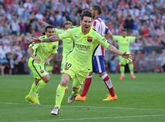 Lionel Messi celebrates after scoring his team's goal during the La Liga match between Club Atletico de Madrid and FC Barcelona at Vicente Calderon Stadium in Madrid, Spain