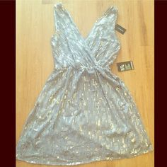 """NWT Sequin Express Party Dress NWT Silver Sequin Express Party Dress  Size M, can easily fit a L. Elastic waist. Length: 37"""" long from top of shoulder to bottom. Ribbon belt is missing. Very pretty!! Express Dresses"""