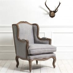 Wing armchair in grey linen