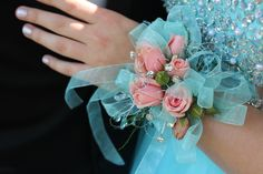 Your flowers and dress do not always have to match......accent with a different color, like these soft pink mini roses