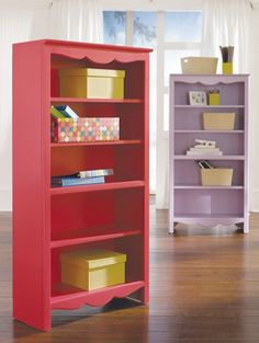I should paint the kid's bookcase and add some wooden prettiness to the top like this one.