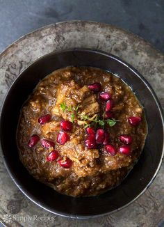 Fesenjan Persian Chicken Stew with Walnut and Pomegranate Sauce ~ Persian chicken stew made with chicken breasts or thighs, slowly cooked with ground toasted walnuts and pomegranate molasses. ~ SimplyRecipes.com