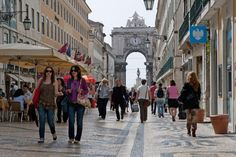 http://www.nydailynews.com/life-style/portugal-foodie-destination-article-1.2675331 Pedestrians pass by stores lining Augusta St. in central Lisbon, Portugal.
