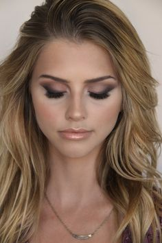 {kissable complexions} Brown smoked-out winged eye shadow with nude lips.
