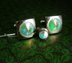 Flashy and sophisticated, these brilliant , almost diamond like, cufflinks and tie tack with chain are stunning. The colors that flash off this are the color of the bahams waters. Here is a great gift idea that shows you took the time to care about that special person in your life. It is classic and vintage and we even gift wrap it for you . Whether it is a memory from their past or something that reminds you of how special they are, it is a unique idea because it is vintage and not…