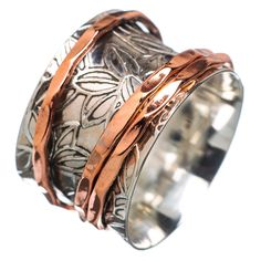 "Solid Sterling Silver and Copper Spinner Ring DETAILS: * Size 7 * 5.4 g total weight * SOLID .925 Sterling Silver * Stamped .925 * Measures approximately 1/2"" wide Spinner Rings are also called Tibeta"