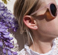 Pink sunglasses, wisteria and lightning bolt Missoma earring. Love.