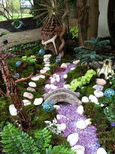 Outdoor Fairy Garden http://thegardendiaries.wordpress.com/2013/04/22/outdoor-fairy-garden-go-wild/