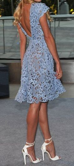 Periwinkle Summer lace dress with open back feature and flounce hem.  Add