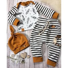 Baby boy gift for baby showers. This high quality newborn boy clothes is printed with stripe pattern. The baby boy clothes comes with 3 pieces, hat, shirt and pant.