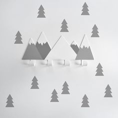 Stylish coat hooks for your children in the fun shape of mountains. Create a scene with the wall sticker trees all designed by Tresxics