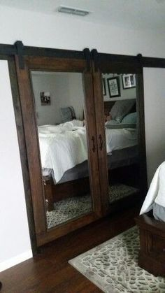 Our own DIY mirrored barn closet doors. Costco standing mirrors converted to sli… Our own DIY mirrored barn closet doors. Costco standing mirrors converted to sliding barn doors! Closet Bedroom, Home Bedroom, Bedroom Decor, Master Closet, Mirror Bedroom, Bathroom Closet, Bathroom Doors, Ikea Mirror, Bedroom Green