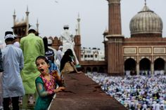 A young Indian Muslim yawns during Eid al-Fitr prayers at the Jama Masjid mosque in New Delhi, Tuesday, July 29, 2014. Millions of Muslims across the world are celebrating the Eid al-Fitr holiday, which marks the end of the month-long fast of Ramadan. (AP Photo/Bernat Armangue)