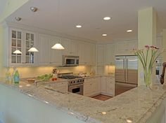 light granite, white cabinets, U-shaped kitchen. I would probably go for a very pale slate color for the walls though