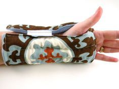 Heating Pad for wrist is a slip on microwave heat wrap for carpal tunnel, tendonitis, arthritis and sore muscles. Easy slip on fit is loose yet