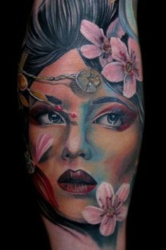 This face amid cherry blossoms looks insanely lifelike. Tattoo by Tony Mancia. #InkedMagazine #InkedMag #inked #ink #portrait #cherryblossom #color #realistic #tattoo #tattoos