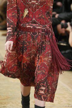 Fringe benefits: a burgundy braided hip belt with long leather tassels