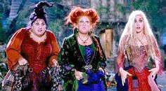 The Sanderson Sisters from Hocus Pocus doing a perfect imitation of what our animals look like with all of the Trick-Or-Treaters ringing the doorbell all night long