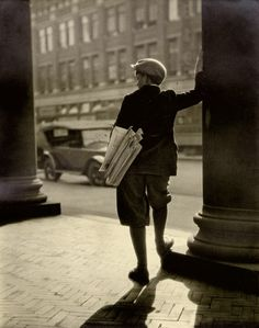 'The Paperboy' from 1931. Nice picture and great example of a profession gone extinct.