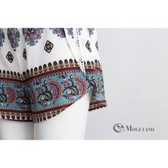 Multi coloured tribal print strappy top and racer short set front