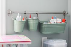 IKEA fintorp buckets for wall storage in a craft room