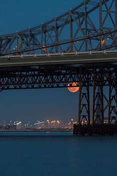 Supermoon 2012  Here is a shot I never posted from the Super Moon back in May. This was taking from Treasure Island of the Eastern span of the Bay Bridge.  Canon 7D Canon 70-200mm f/4 L f/4.0 1/6 Sec 131mm ISO 100