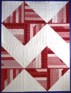 red and white quilt. pay attention to the quilting.