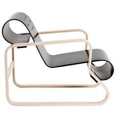Designer: Alvar Aalto Piece: Armchair 41, Paimio Design: 1930 - 1 Production: 1932 to the present Manufacturer: Oy. Huonekalu-ja Rakennustyötehdas AB, Turku, Finland for Artek Oy. AB, Helsinki Size: 62.5 x 61 x 88; seat height 34 cms Material: bent plywood, bent laminated birch wood frame