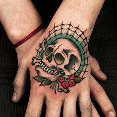 Hand Tattoos for Men: Discover Awesome Hand Ink Examples Le Tattoo, Tattoo Fonts, Skull Hand Tattoo, Skull Tattoos, Body Art Tattoos, Pin Up Tattoos, Traditional Tattoo Skull, Traditional Tattoo Old School, Hand Tattoos For Guys