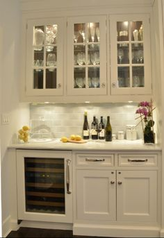 Kitchen Organization - Design Chic - the perfect bar - love the wine frog and great glass shelves and undercounter lights
