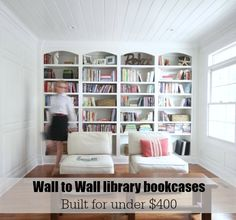 Library wall to wall bookcases - free and easy plans from https://sawdustgirl.com.