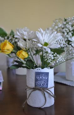 Craft:  Cans   ~ Teacher Appreciation Vases.  Would be great for Bridal or baby showers too!  Take a Tin can and paint it white.  Use spray glue and attach paper doily.  Embellish with ribbon, twine and printed quotes!