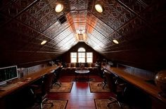 Attic remodel into an office. Love the tin ceiling panels and the extra long work benches! So much potential!