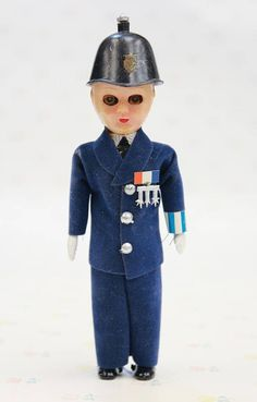 An antique plastic soldier boy doll, suspected from the 1950s. If you love to get creeped out by shiny hard plastic dolls with hollow, sleepy eyes - this collectible celluloid soldier boy is just for you! If you find him to be rather dapper and charming, great! He wont give you