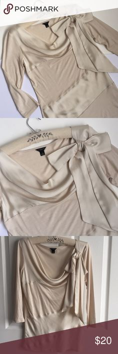 """Ann Taylor Mixed Media Satin Top Ann Taylor Mixed Media Satin Top in Ivory color. Satin side bow detail on top left chest. 3/4 sleeves. Cowl neckline. Satin front panels. 16.5"""" pit to pit. 24"""" shoulder to hem. Excellent condition. Ann Taylor Tops Blouses"""