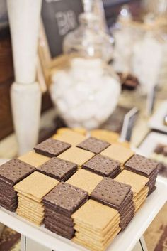 Checkerboard graham cracker squares at a 40th s'mores birthday party!  See more party planning ideas at CatchMyParty.com!