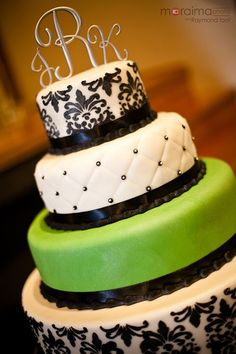Black, white and green wedding cake.